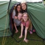 bronze dofe 2019 group in a tent.