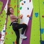 Year 10 Geography Student on a Climbing Wall at Calshot Activities Centre.