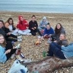 Year 10 Geography group at Calshot beach enjoying marshmallows.